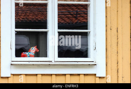 Dalahast or Dalecarlian horses (Swedish dala horse) inside of window - Stock Photo