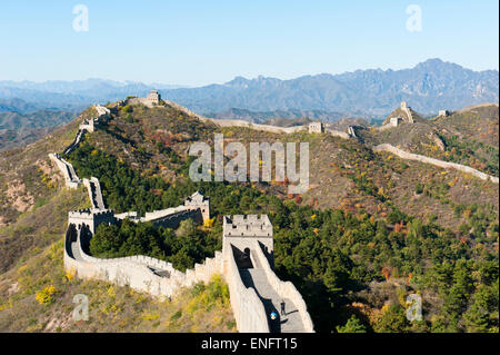 Great Wall of China, historical border fortress, restored section with watchtowers, winding its way over mountain - Stock Photo