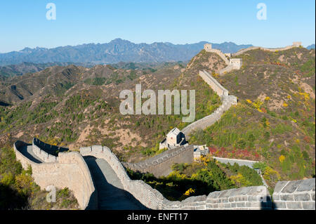Great Wall of China, historical border fortress, restored section with watchtowers, winding through the mountains, - Stock Photo