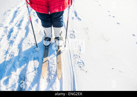 Caucasian woman cross-country skiing in snowy field - Stock Photo
