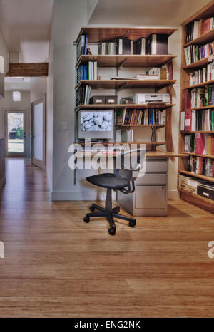 Empty desk and bookshelves in natural healing clinic office - Stock Photo