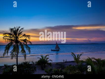 Dhow In The Sunset, Lamu County, Kizingoni Beach, Kenya - Stock Photo