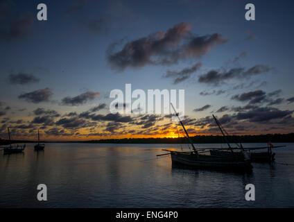 Fishing Dhow Moored Along Coastline At Sunset, Lamu County, Matondoni, Kenya - Stock Photo