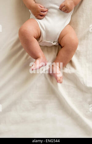 Close up of legs of mixed race baby boy - Stock Photo