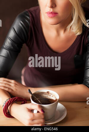 Woman drinking cup of coffee - Stock Photo