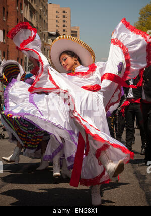 Folk dancers in the Cinco de Mayo Parade in New York on Sunday, May 3, 2015. The holiday commemorates a victory - Stock Photo