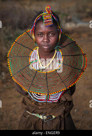 A Pokot Girl Wears Large Necklaces Made From The Stems Of Sedge Grass, Baringo County, Baringo, Kenya - Stock Photo