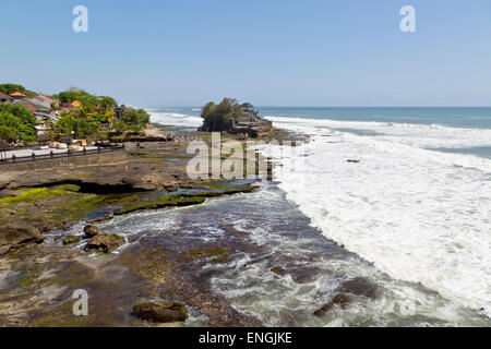 Distant View onto the Temple Pura Tanah Lot, Bali, Indonesia - Stock Photo