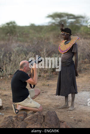 Tourist Taking A Picture Of A Pokot Woman Who Wears Large Necklaces, Baringo County, Baringo, Kenya - Stock Photo
