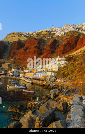 The port of Ammoudi with Oia up the hill, Santorini island - Stock Photo