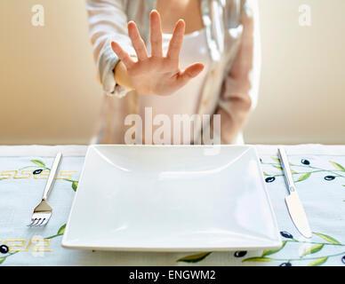 Woman refusing food - Stock Photo