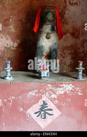 Dog shrine, Japanese Covered Bridge, Hoi An, Vietnam - Stock Photo