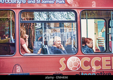 Red Bus Passing by in the City - Stock Photo