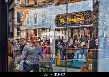 Reflections at The bus Stop in a Busy City - Stock Photo