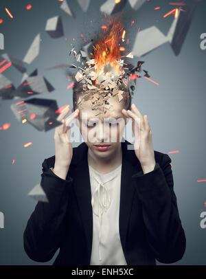 Smart businesswoman with exploding headache - Stock Photo