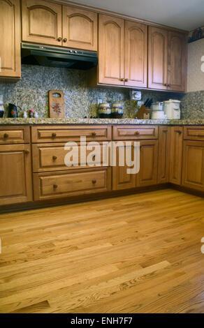 Kitchen with oak cabinets & oak wooden floor in San Jose, California, USA - Stock Photo