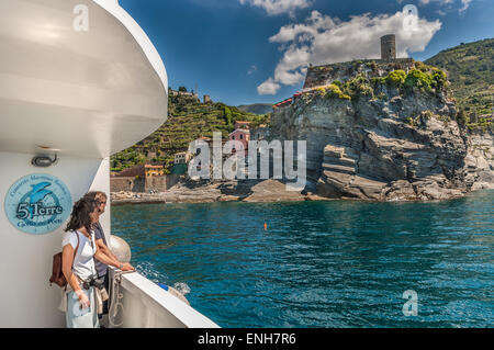 Tourist couple on Gulf of Poets Maritime Tourist Consortium Boat, viewing Cinque Terre and Italian Riviera - Stock Photo
