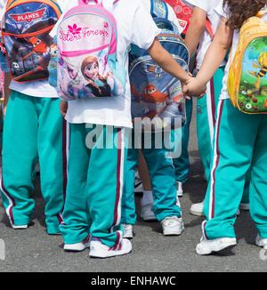 Spanish schoolchildren on field trip wearing backpacks - Stock Photo