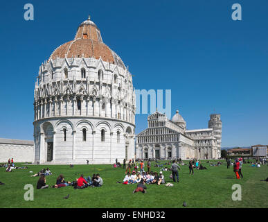 The Baptistery and the Cathedral of Pisa, the Leaning Tower behind, Pisa, Tuscany, Italy - Stock Photo