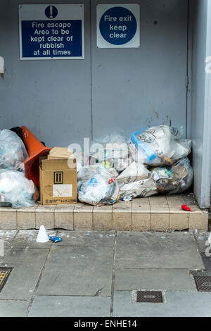 Rubbish blocking a fire exit in New Canal Salisbury - Stock Photo