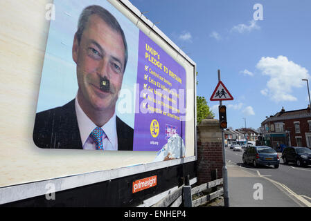 On a UK Independence Party, 2015 election poster a black moustache has been drawn onto the photo of the UKIP leader - Stock Photo