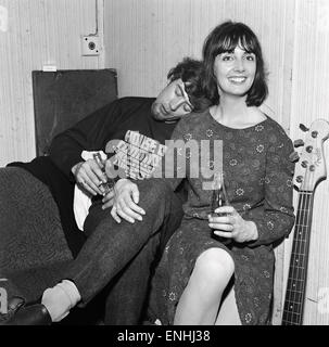 Pioneering English blues singer and musician John Mayall takes a nap on the shoulder of his wife Pamela in the band - Stock Photo