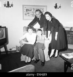 Tv presenter Hughie Green seen here at home with his family. 4th December 1957 - Stock Photo