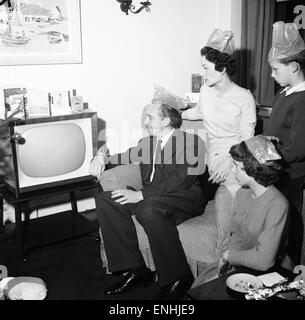 Tv presenter Hughie Green seen here at home at Christmas time with his family. Left to right Hughie Green, wife - Stock Photo