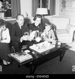 Tv presenter Hughie Green seen here at home with his family. Left to right daughter Linda Hughie Green, wife Clair - Stock Photo