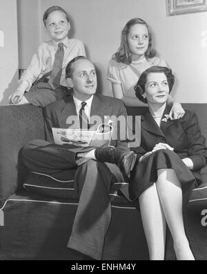 Tv presenter Hughie Green seen here at home with his family. Circa 1955 - Stock Photo