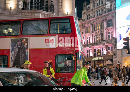 Cyclist waiting for the traffic light ,Piccadilly Circus at night,London,England - Stock Photo