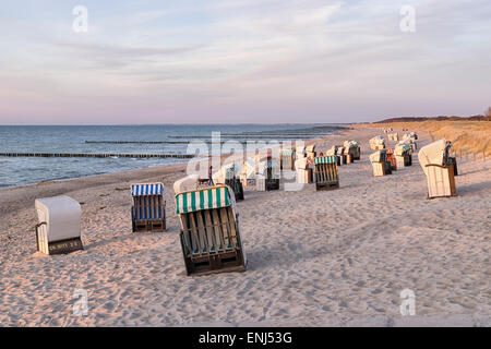 Beach chairs on the beach with dunes on the Baltic Sea in Germany at sunset - Stock Photo