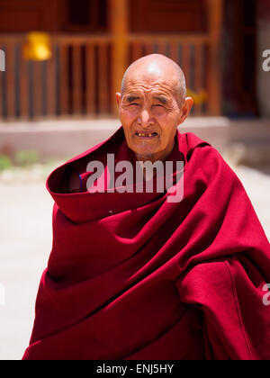 Elderly monk in Buddhist monastery in Lo Manthang, Upper Mustang, Nepal - Stock Photo