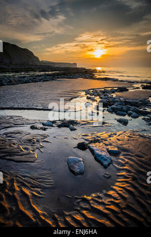 Sunset over Kilve beach Somerset. - Stock Photo