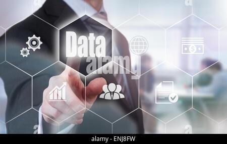 Businessman pressing a Data concept button. - Stock Photo