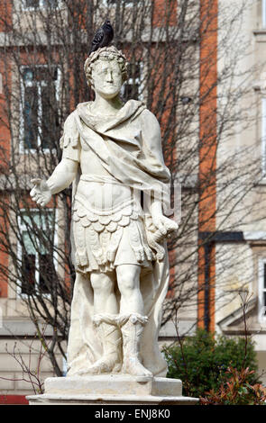London, England, UK. Statue: George III (1893-1760) in Golden Square (1753; John Van Nost) badly eroded Portland - Stock Photo