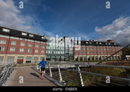 Radisson Blu Hotel Durham exterior Durham city centre with a morning runner in the foreground - Stock Photo