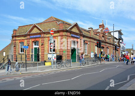 Upton Park underground train station entrance built on a road bridge above railway lines in East London on the District - Stock Photo