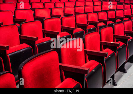 Rows of empty red seats in a theater - Stock Photo