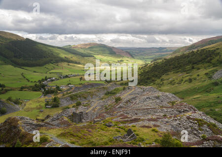Looking down the welsh valley of Cwm Penmachno, disused slate quarry in foreground. Snowdonia, Wales, United Kingdom - Stock Photo