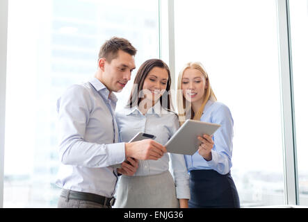 business team working with tablet pcs in office - Stock Photo