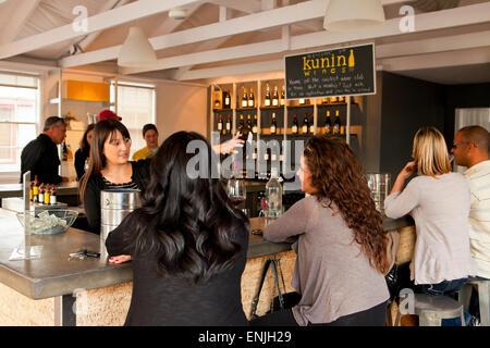 Tourists Wine Tasting At Kunin Wines Funk Zone Santa