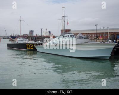 motor torpedo boat 102 and  Motor Gun Boat 81 at Portsmouth Historic Dockyard, England - Stock Photo