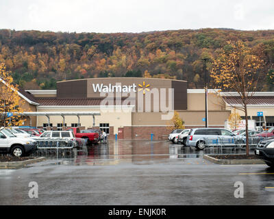 Exterior of a small town Walmart store on a rainy fall day. - Stock Photo