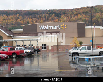 Exterior of a small town Walmart store on a rainy day. - Stock Photo