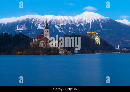 The Assumption of Mary Pilgrimage Church on Lake Bled and Bled Castle at Dusk, Bled, Slovenia, Europe - Stock Photo