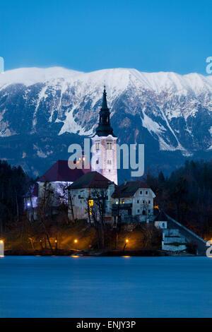 The Assumption of Mary Pilgrimage Church on Lake Bled at Dusk, Bled, Slovenia, Europe - Stock Photo