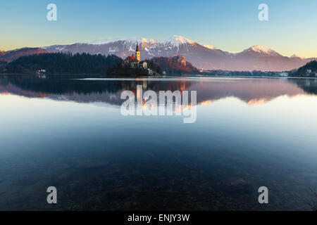 The Assumption of Mary Pilgrimage Church on Lake Bled and Bled Castle, Bled, Slovenia, Europe - Stock Photo