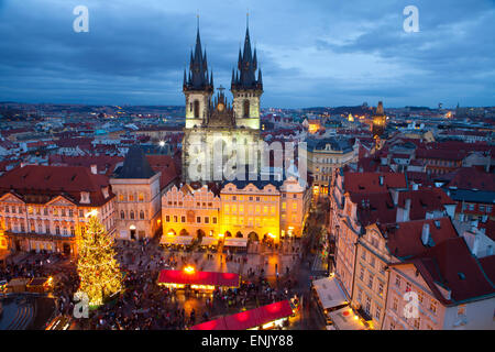 Overview of the Christmas Market and the Church of Our Lady of Tyn on the Old Town Square, UNESCO, Prague, Czech - Stock Photo