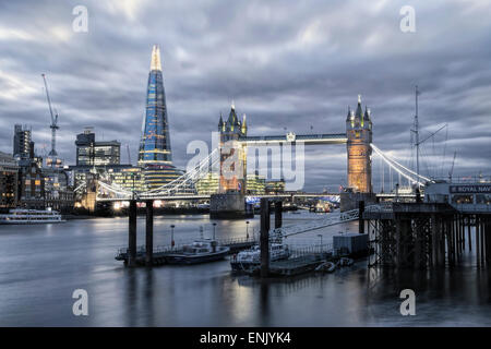 The River Thames, Tower Bridge, City Hall, Bermondsey warehouses and the Shard at night shot from Wapping, London, - Stock Photo